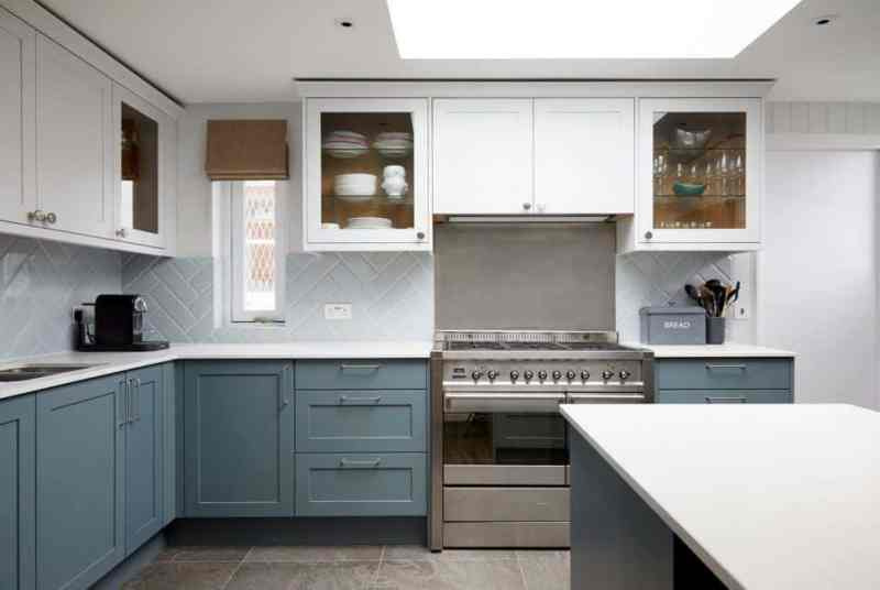 Kitchen design trends - grey lower cabinets and white upper cabinets. Design by Kia Designs