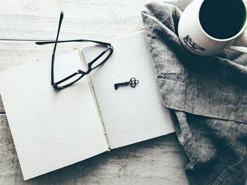 key on sketchbook