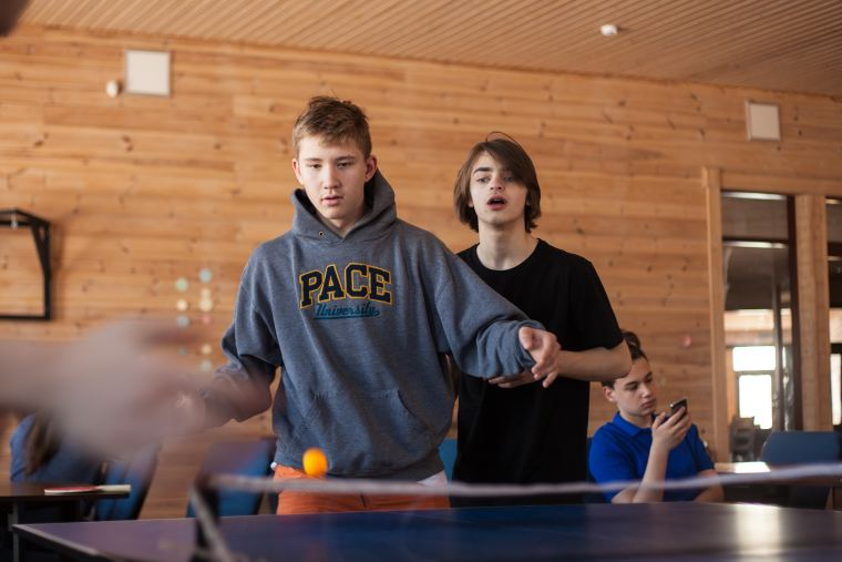 boys playing table tennis