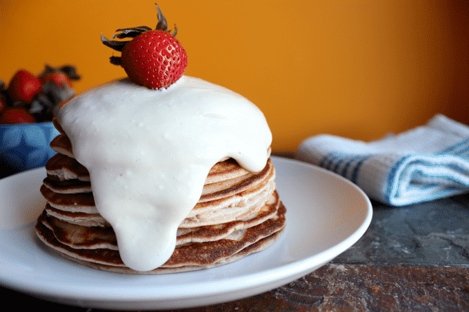 The BEST protein pancake recipe. These healthy strawberry cheesecake protein pancakes are truly a dream come true. #proteinpancakes #healthypancakes