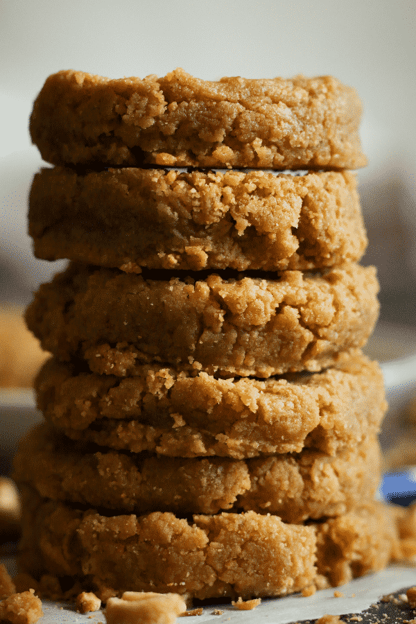 Keto peanut butter cookies stacked on top of each other.