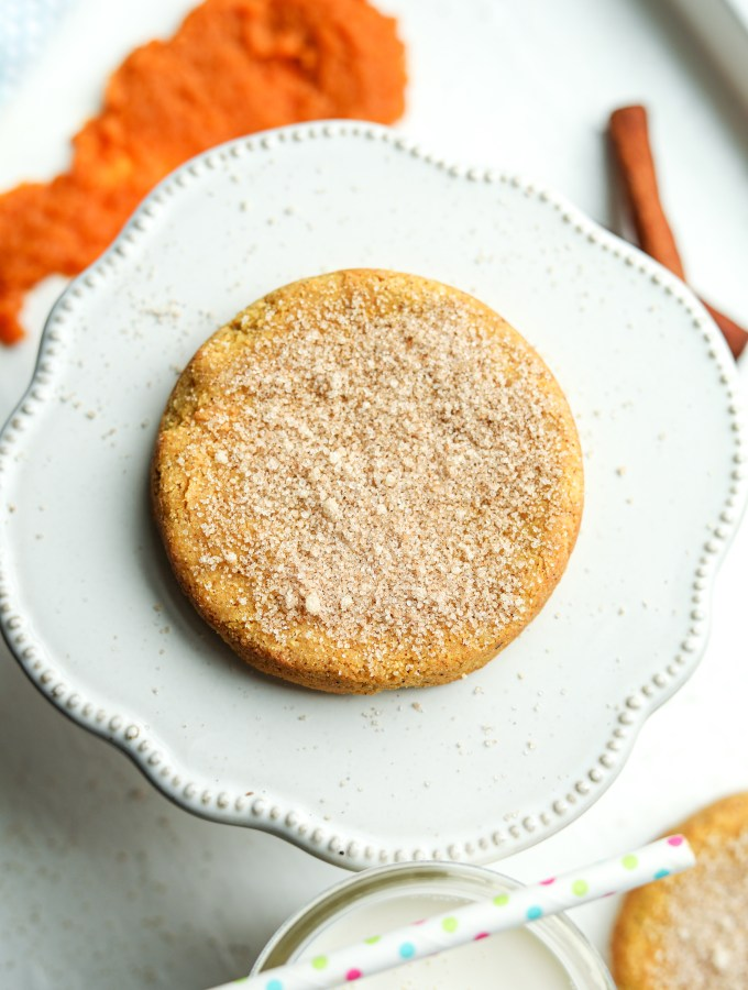 A pumpkin spice cookie resting on a serving plate.
