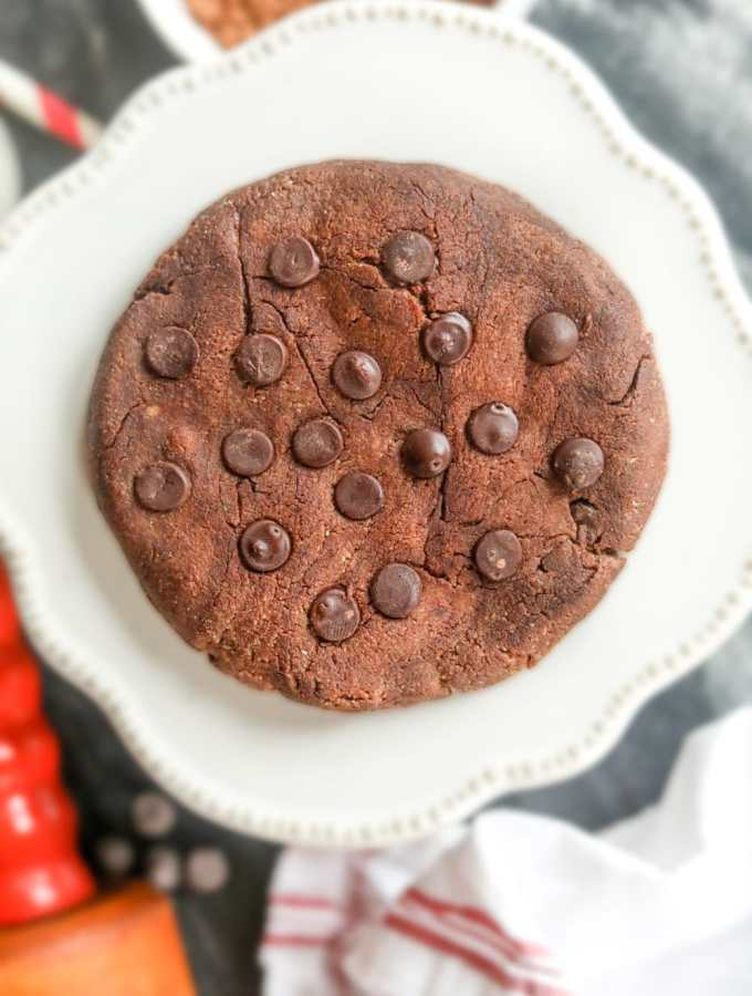 A keto double chocolate chip cookie on a plate.