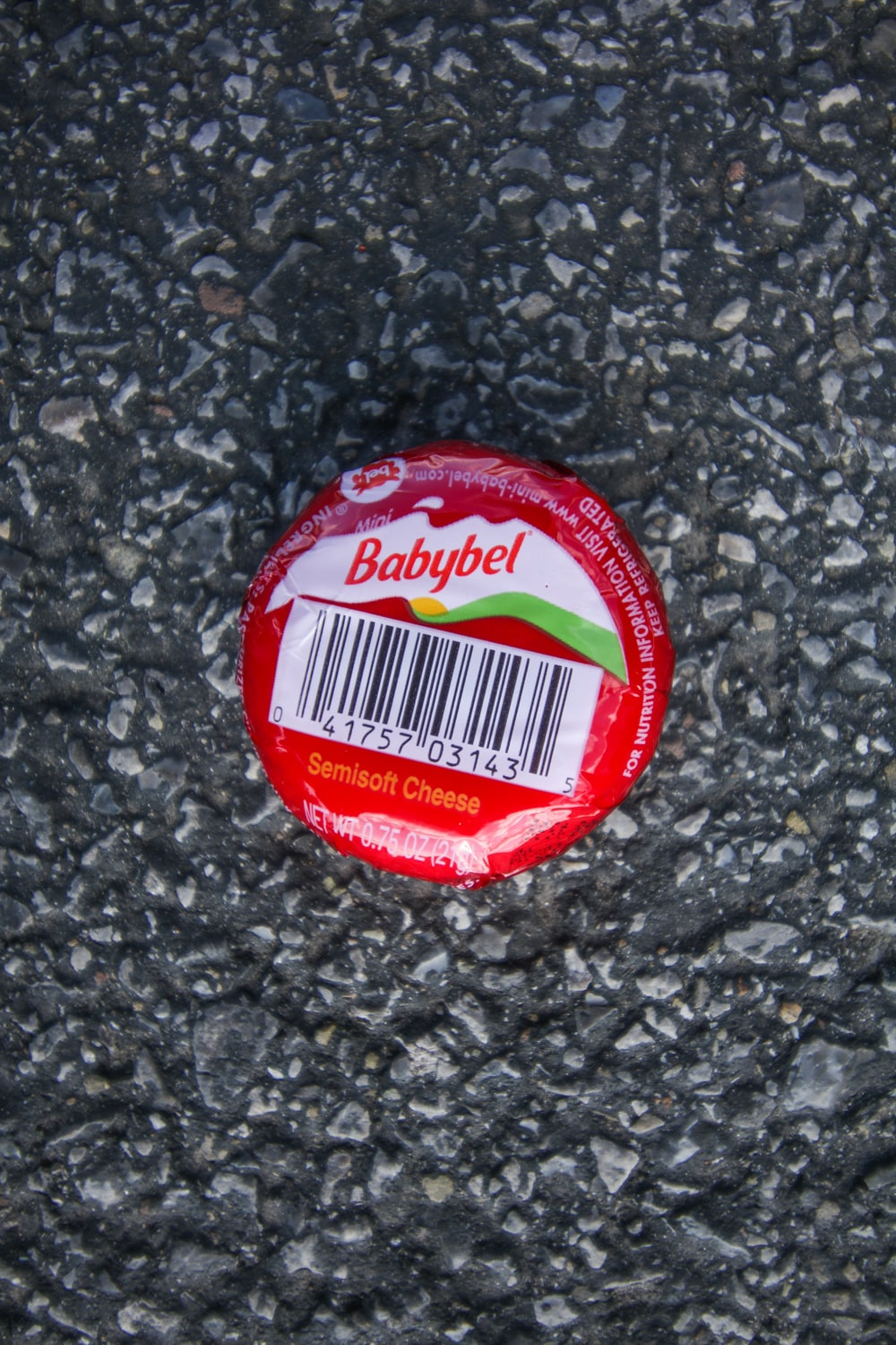 A single-serve Babybel cheese wheel.