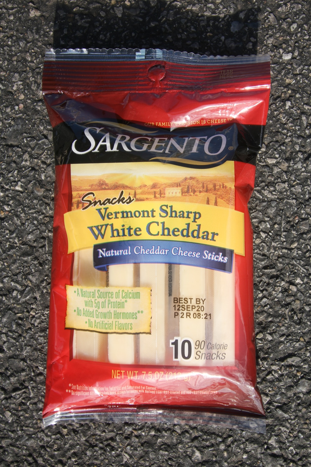 A package of white cheddar cheese sticks.