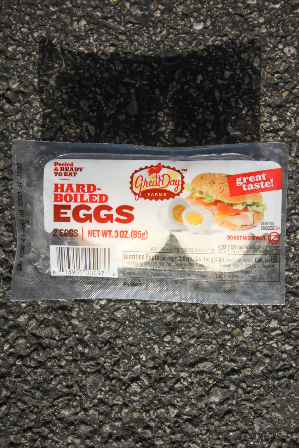 A package with 2 hard boiled eggs in it.