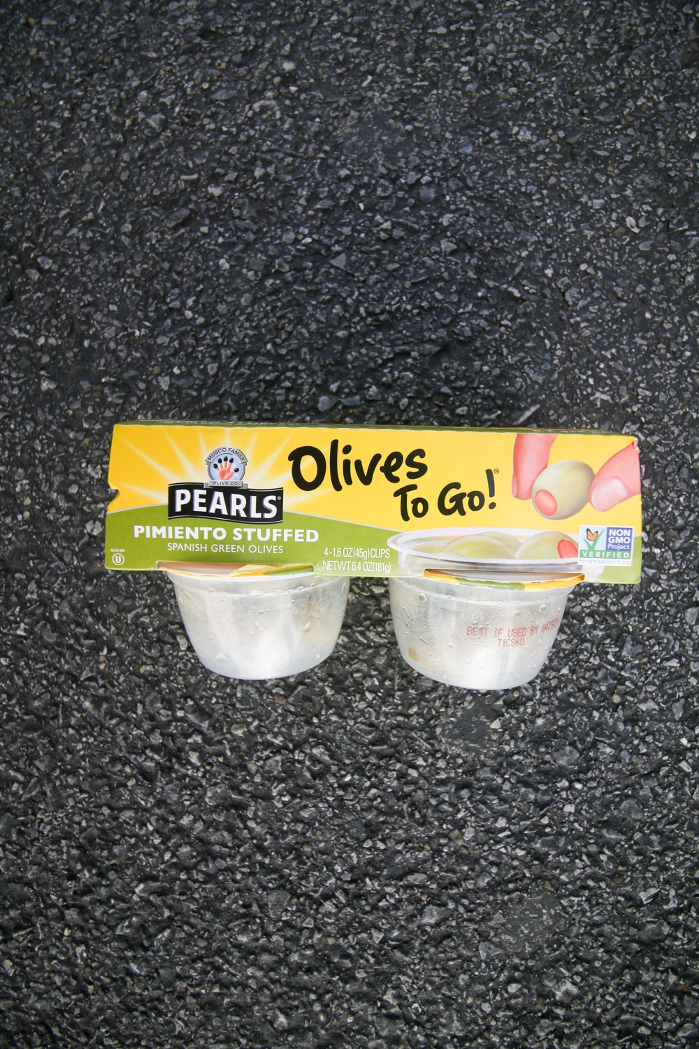 A package of olive snack packs.