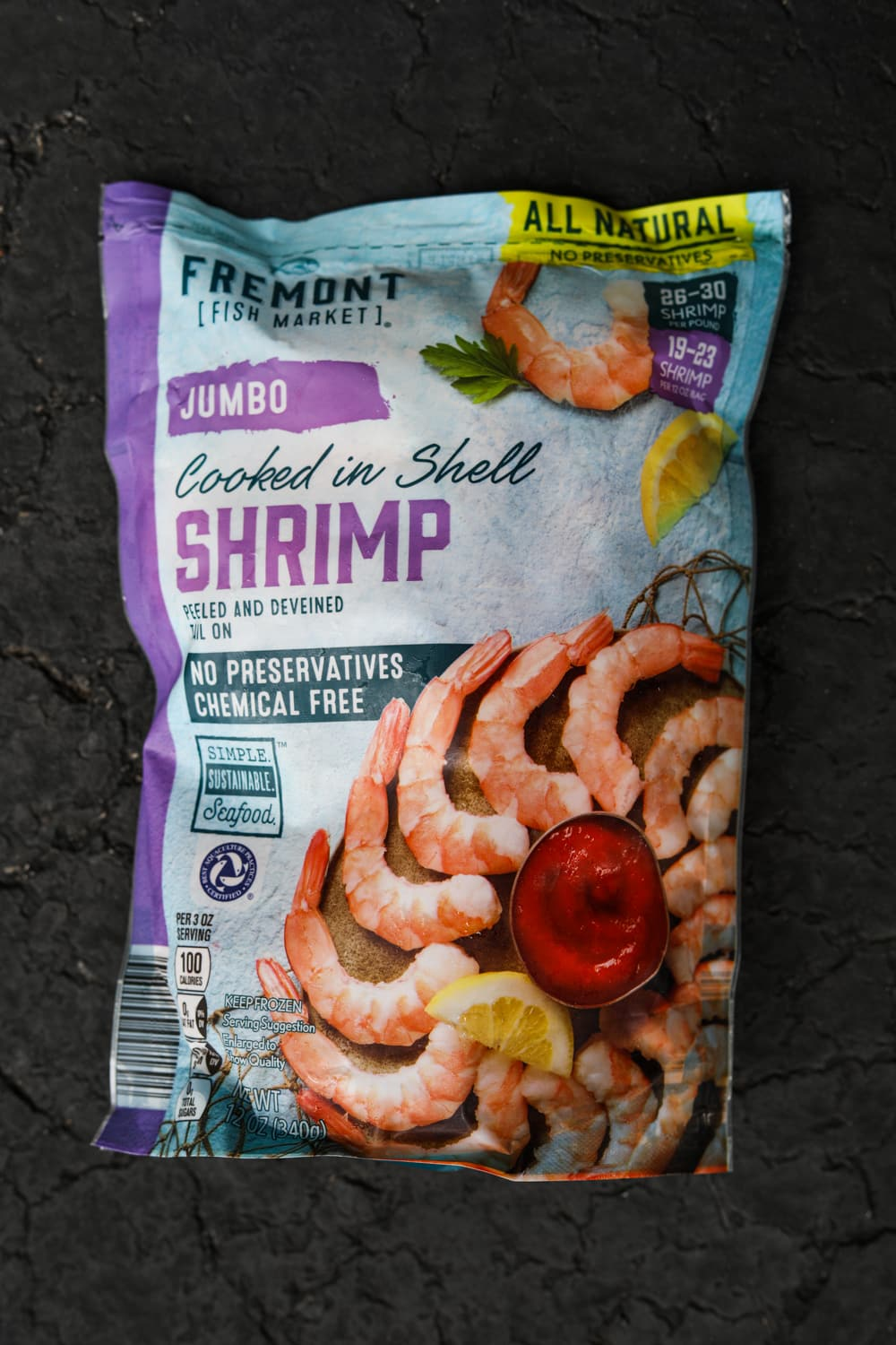 A large package of cooked shrimp.