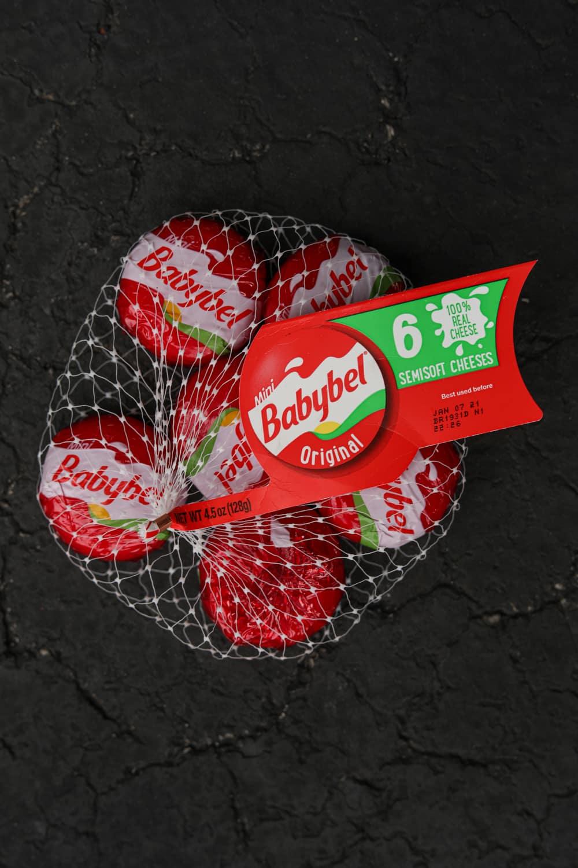A bag of Babybel mini cheese wheels.