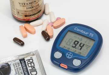 a blood sugar testing kit and other diabetic medicines on a table
