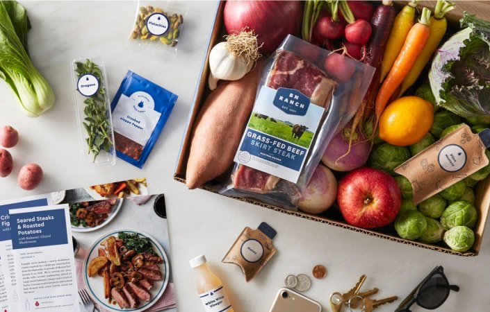 a table full of blue apron ingredients