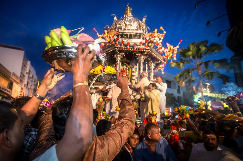 And offering of bananas and coconut and money are brought to the chariot.