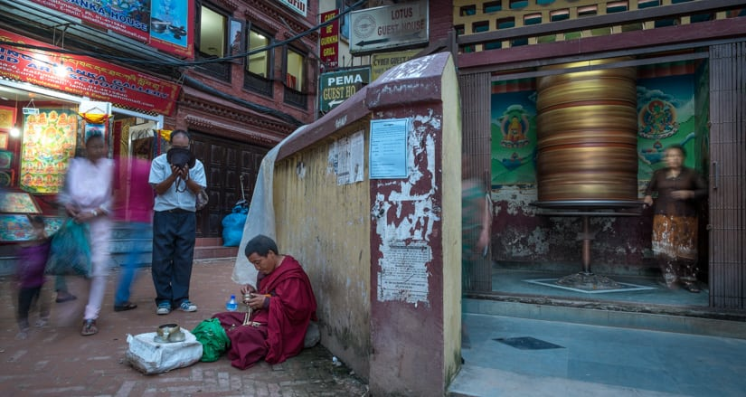 If you can't photograph a monk, then photography life around a monk.  f/7.1, 1/2 sec, at 14mm, 400 ISO, on a X-Pro1