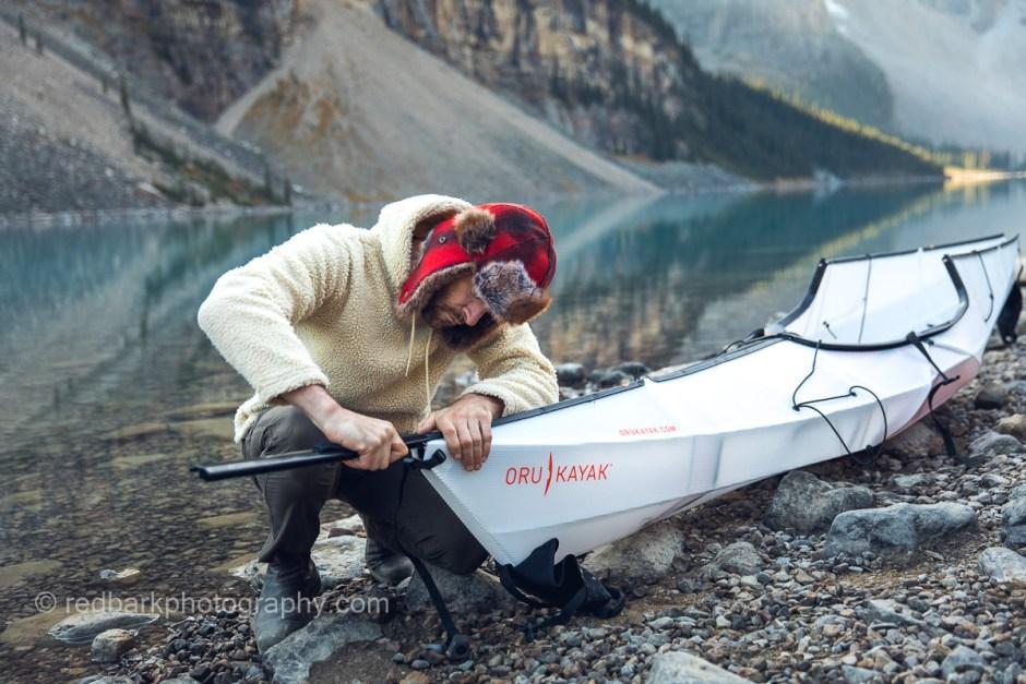 Man putting an oru foldable kayak together