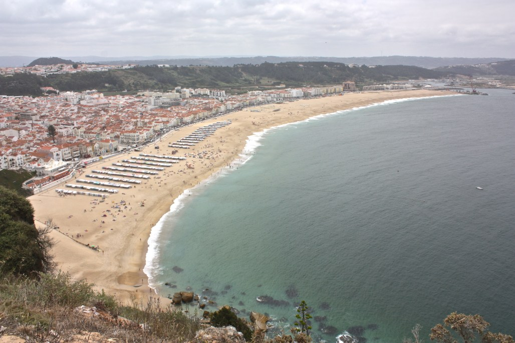 Traveling to ..... atop the picturesque views of Nazaré's coastline || The Sitio