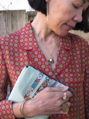 Adorn your pajama blouse with simple yet elegant jewelry - earrings from Abacus Gallery (Portland, ME), Kate Peterson necklace (El Cerrito, CA), purse from Japan that was given to me by my sister, Lava 9 Lucite ring (Berkeley, CA), and cuff and rings from Sundance (Corte Madera, CA).