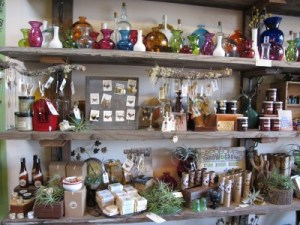The shelves are stocked with glassware, jewelry, natural bath and body products, and more goodies.