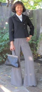 1950s retro: structured jacket, wide-leg pants, and antique handbag.