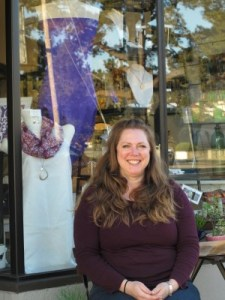 Peterson relaxes in front of Adorn & Flourish on a sunny winter day.
