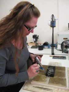 The artist at work in her studio.