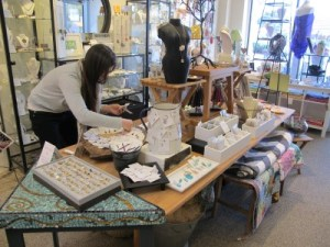 Marika Munkres, Peterson's assistant and fellow artist, arranges the center display.