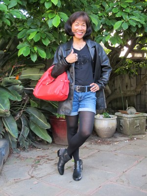 Jean shorts and black opaque tights create a classic look. Keep it simple with black embellished t-shirt, belt, and leather jacket. But give it an edge with a red bag and studded booties.