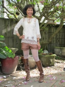 Vegan leather and Frye boots are softened by a creamy lace blouse and tights.