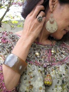 Playing up a blooming spring blouse with earrings from a New York City street fair, Sundance flower ring, Anthropologie statement necklace, and a water buffalo horn cuff from my sister's trip to Kenya.