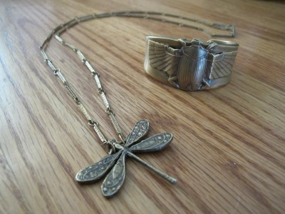 Dragonfly necklace and beetle cuff made from reclaimed metal by Alkemie of Los Angeles.