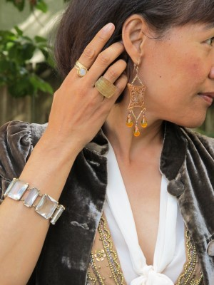 Rich chocolate velvet, golden sequins, and ethereal bow-tie peplum blouse, with Carmela Rose reclaimed chandelier earrings, Lava 9 statement ring (Berkeley, CA), and J. Crew bracelet.