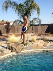 """Jacob jumping off of the """"rock"""" at his cousin's pool in Lemoore."""