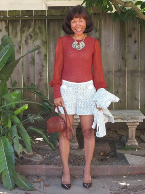 Matching jacket and shorts in cream and green lace work well with a shirred burnt orange blouse.