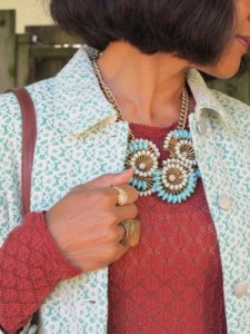 A statement necklace and ring are all you need.