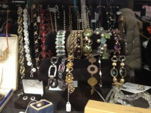 Glass cases dripping with vintage jewels.
