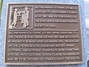 A plaque on Exchange Street highlights the historical importance of second-hand clothing stores during the Underground Railroad and for African-Americans.