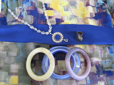 Harmonious accessories for a colorful silk sheath.