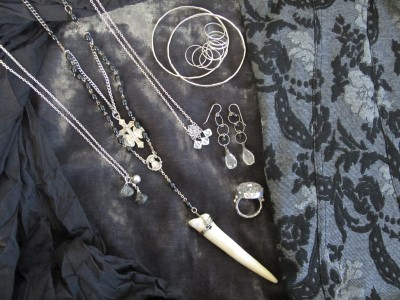 Vintage vibe: Carmela Rose bracelets, earrings, and two delicate necklaces; Elizabeth Ng antique Edwardian button ring (Abacus, Portland, ME); and reclaimed vintage rosary necklace (Feathers, Austin, TX).