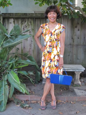 A retro dress with a vintage electric blue handbag from the Brooklyn Flea Market. Normally a sundress, but in the fall, throw on a thick cardigan and boots, and you've transitioned from summer to fall.