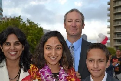 Sofia at her high school graduation, with her parents and brother, Nic.