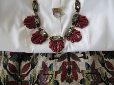 A perfect accessory match! Vintage Bakelite-inspired necklace with resin fanned leaves. Highlight it against a crisp white button-down blouse.