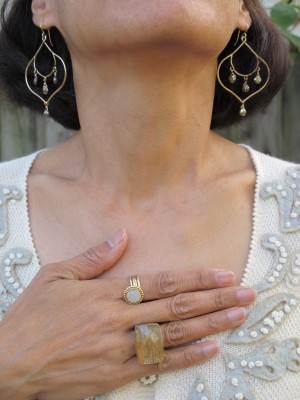 Carmela Rose earrings (Jenny K, El Cerrito, CA), Sundance stack of rings, and Lava 9 chunky ring (Berkeley, CA).