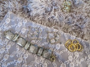 Close-up: Kate Peterson Designs stack of rings, J. Crew glass bracelet, Carmela Rose earrings, and vintage Weiss brooch.