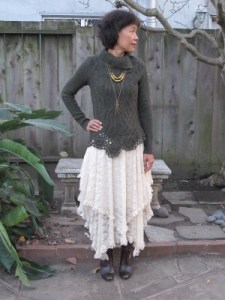 Comfortable clothing is a must to be at rest: cozy sweater with hem detail over lace dress with asymmetrical layers of lace.