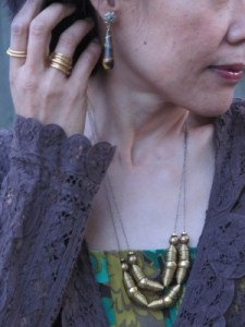 Laura Lombardi necklace (Eskell, Chicago), Kate Peterson Designs stack of rings (Adorn & Flourish, El Cerrito, CA), and Anthropologie earrings.