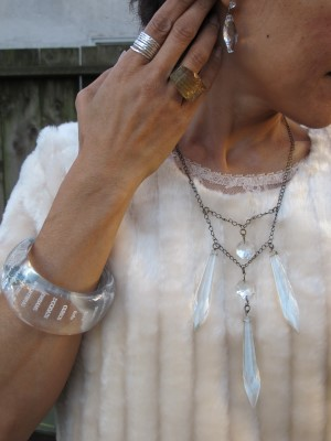 A peek of lace beneath faux fur and Sundance stack of rings, Anthropologie clear bangle, End of Century vintage chandelier crystal drop necklace (NYC), and crystal earrings.