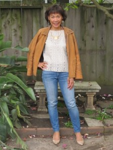 Worn-out leather and jeans who well with vegan cut-out blouse.