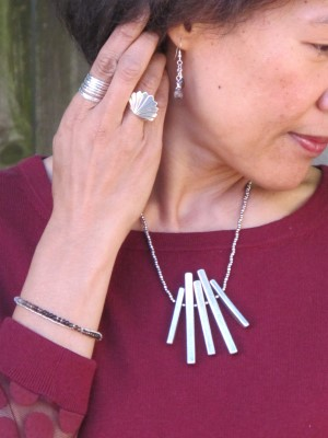 Featuring earrings and double-strand bracelet by Anja Hakoshima (El Cerrito, CA), architecturally inspired necklace (Wyler's, Portland, ME), fan ring (Eskell, Chicago), and Sundance stack of rings.