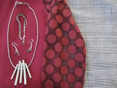 Close-up of silver accessories against dots and plaids.