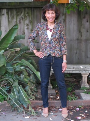 Joy is a comfortable spring uniform: blazer abloom with flowers, jeans, and kitten-heel pointy pumps.