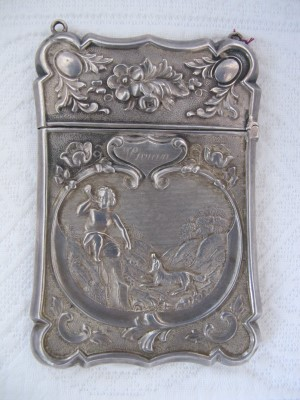 "Antique document holder with the name ""Vivian"" engraved on it."